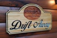 Custom Wood Sign for a vacation cabin rental in the smoky mountains featuring a 3 Dimensional scene of a cabin by the lake.
